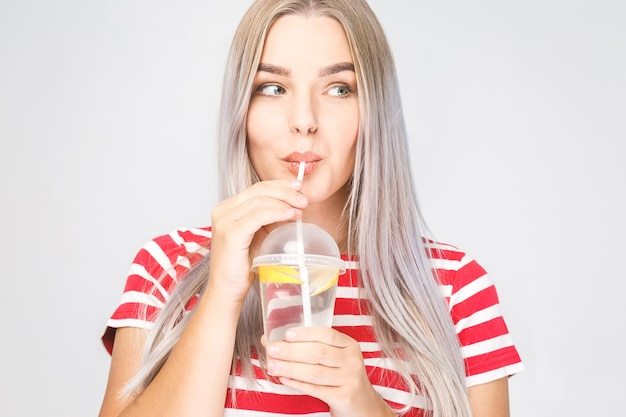 Face portrait of woman drinking water