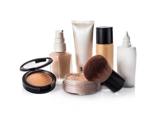 Face powder and liquid foundation isolated on white Premium Photo
