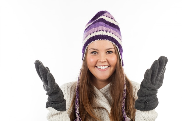 Face of pretty woman with gloves and knitted winter cap  with smile