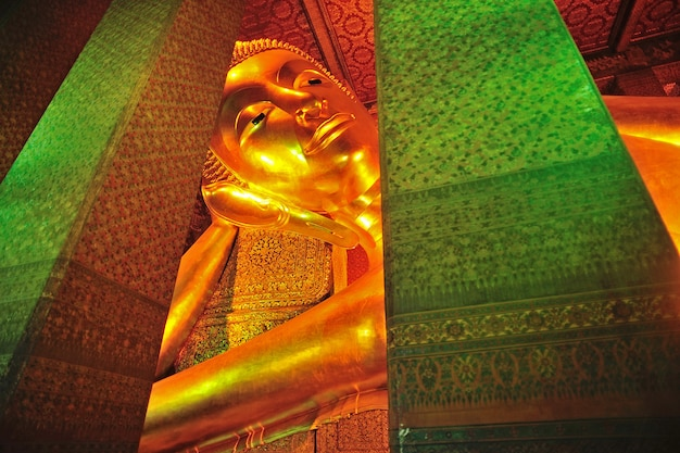 The face of reclining buddha statue in thailand buddha temple wat po