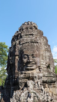 Face tower at the bayon temple in angkor wat complex, siem reap cambodia