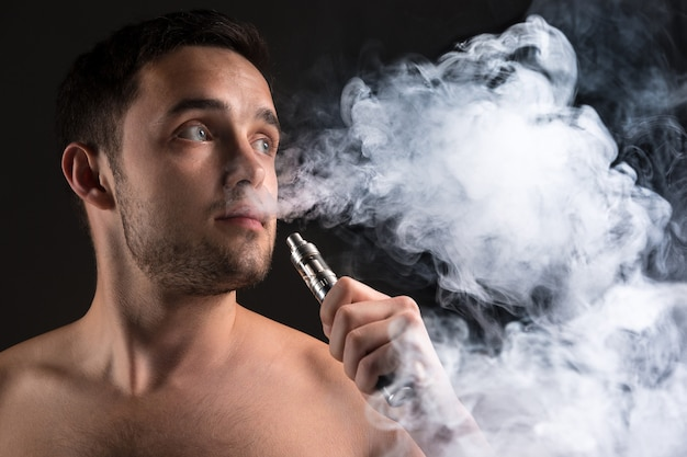 Face of vaping young man