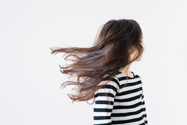 Faceless girl shaking hair