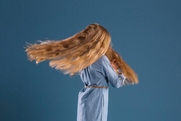 Faceless girl spinning around