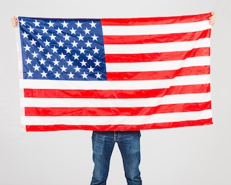 Faceless man behind USA flag