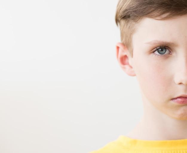 Facial close up of a half attractive boy face