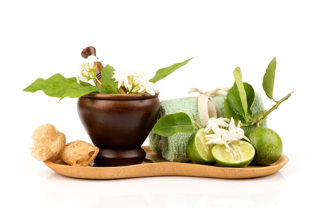 Facial mask to cure blemishes with jasmine and lemon juice for skin treatment isolated on white .