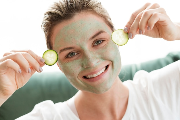 Facial mask and slices of cucumber