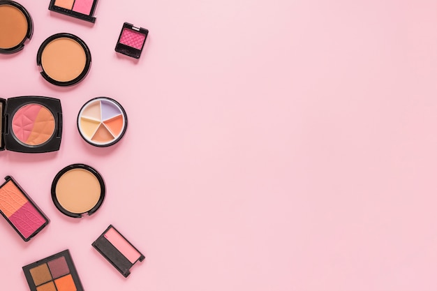 Facial powders with eye shadows on table