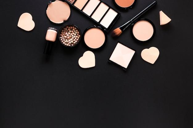 Facial powders with nail polish on table