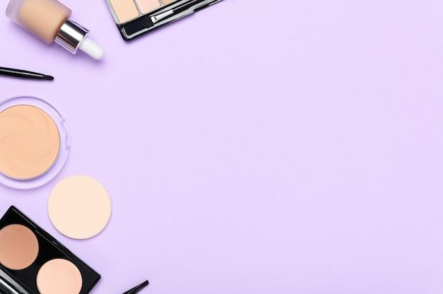 Facial skin correction cosmetics on light purple background.