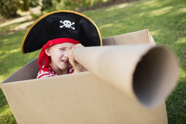 Facing view of little boy pretending to be a pirate