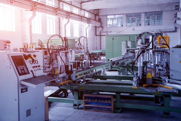 Factory for aluminum and pvc windows and doors production. details industrial equipment.