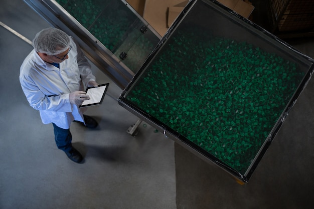 Factory engineer using digital tablet in the factory