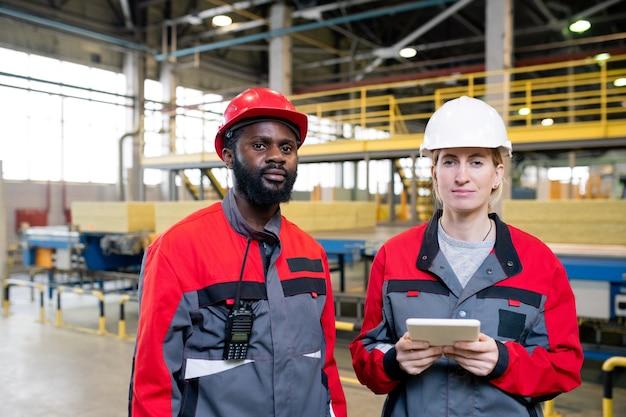 Factory engineers posing