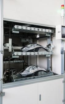Заводское оборудование контроля качества автомобильных фар