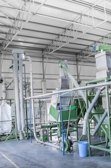 Factory equipment for processing and recycling of plastic bottles. pet recycling plant