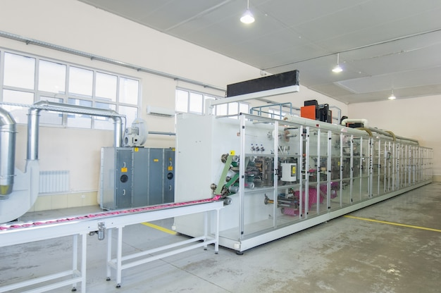 Factory and equipment for the production of female sanitary napkins.