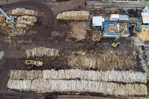 Factory for processing wood from above with a drone