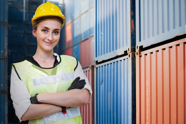 Factory woman worker is standing with confident with working suit green reflect