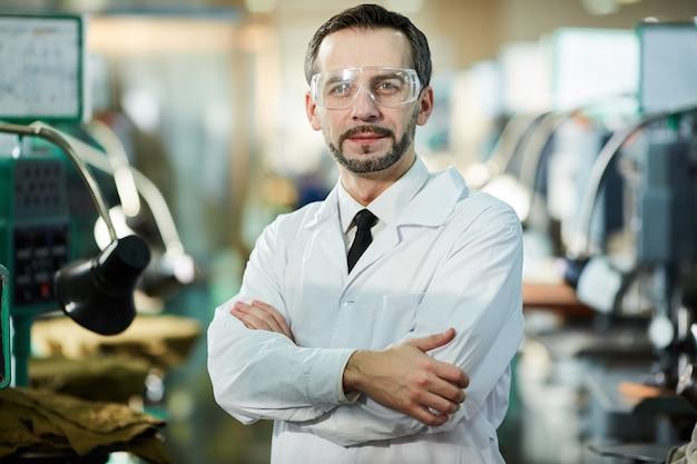 Factory worker wearing lab coat