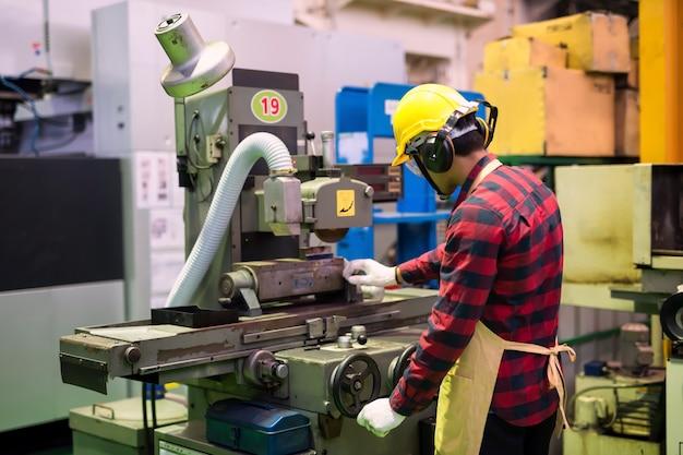 Factory worker work on lache iron machine