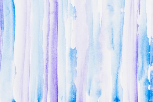 退色した青と紫の水彩ブラシストロークの背景
