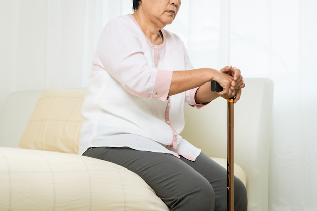 Faint, headache, stress of old woman with stick, healthcare problem of senior concept