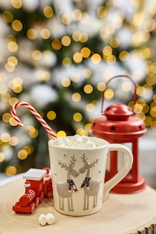 Fairy lights background, hot cocoa with marshmallows