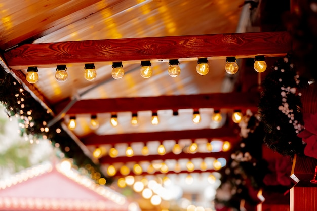 Fairy lights decoration of wooden houses on christmas market in wroclaw, poland