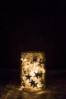Fairy lights and ornament stars in tin