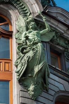 Fairy statue on a building, singer house, nevsky prospekt, st. petersburg, russia