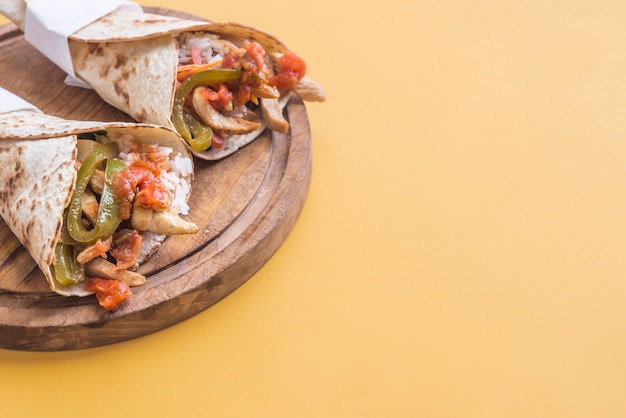 Fajitas and ingredients in yellow background