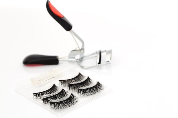Fake false eyelash with curler on white background