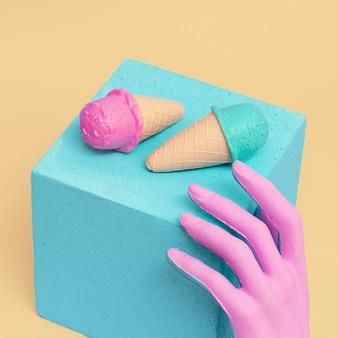 Поддельная рука и поддельное мороженое. минимальное пластиковое визуальное искусство