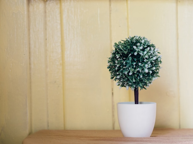 Fake plastic plant in pot for decoration.