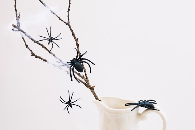 Fake spiders on branch