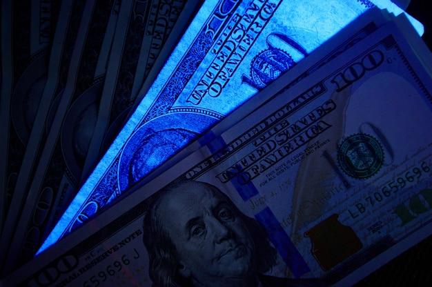 Fake us dollar bill in uv light