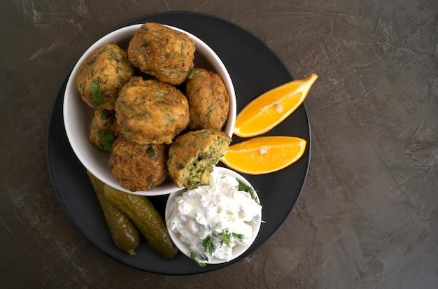 Falafel. balls of chickpeas deep-fried. on dark background.