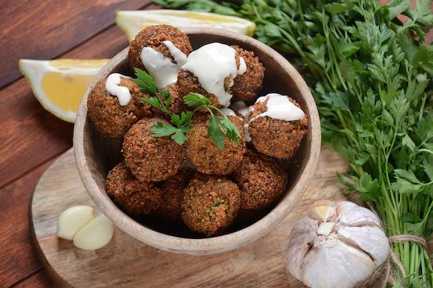 Falafel balls with parsley and tahini