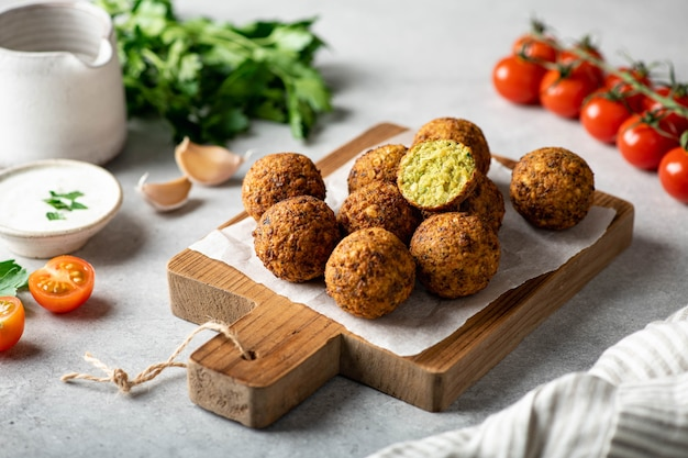 Falafel balls on a wooden cutting board, selective focus