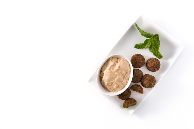 Falafel on a plate isolated on white, top view copyspace