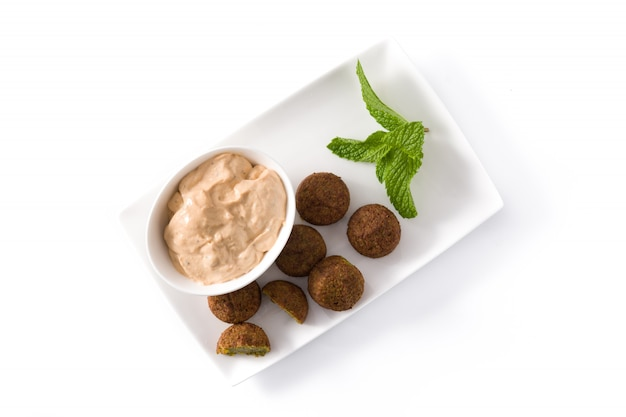 Falafel on a plate isolated on white, top view