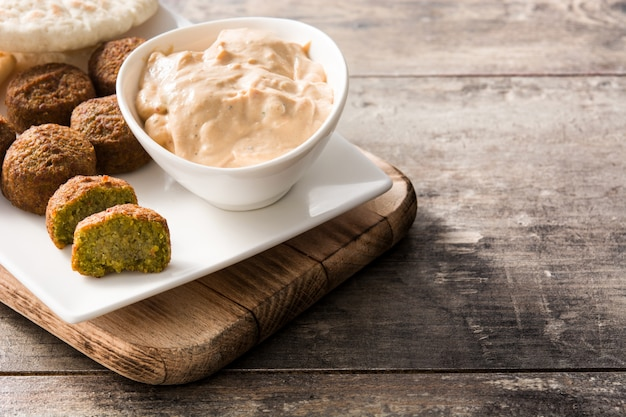Falafel on a plate on wooden table copyspace middle east food