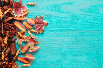 Fall autumn foliage on wooden background