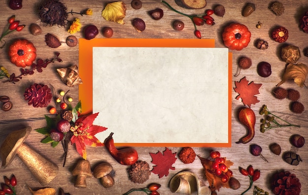 Fall background and mockup with blank paper and  autumn decorations