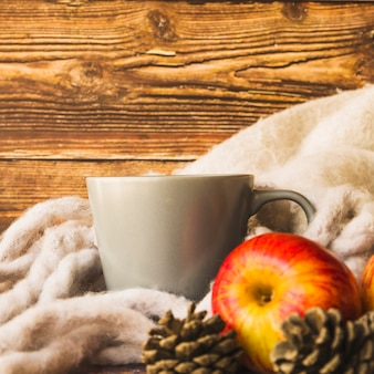 Fall composition with scarf and cup