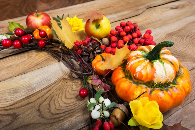 Fall decor with pumpkin and red berries,