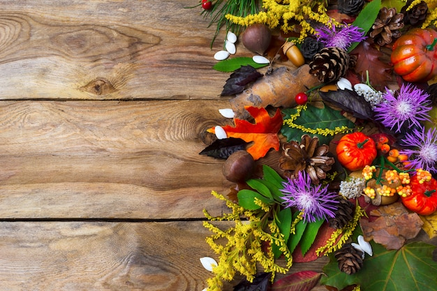 Fall greeting with purple autumn flowers on wooden table