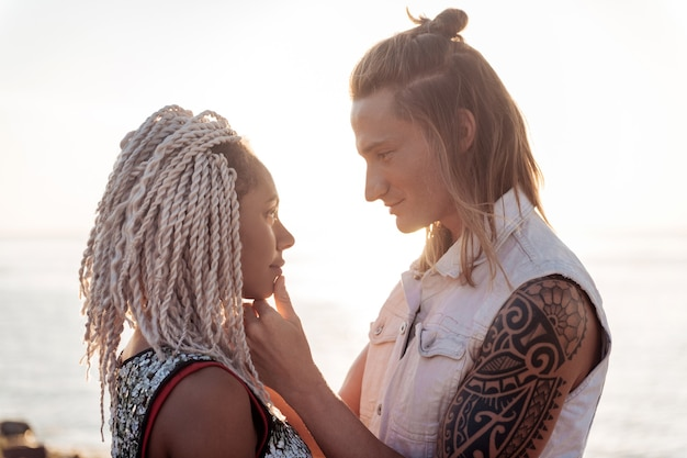 Fall in love. beautiful woman with dreadlocks falling in love with handsome man looking at him